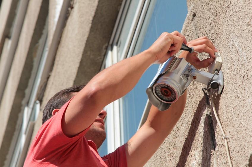guy-installing-surveillance